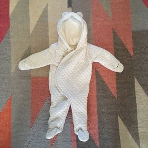 Quilted baby bodysuit with bear hood